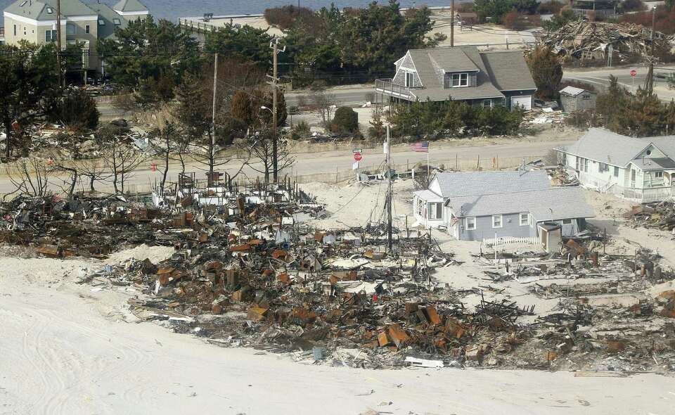 Burned homes line the beach in Camp Osborn in Brick Twp., N.J. Sunday, Nov. 18, 2012, that was cause