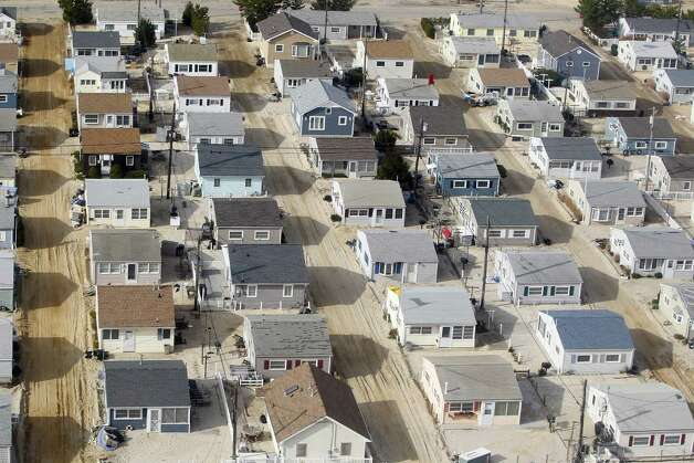 Streets in Ortley Beach, N.J., are still covered in sand from Superstorm Sandy Sunday, Nov. 18, 2012. Vice President Joe Biden was on another helicopter surveying the same damage. Photo: Rich Schultz, AP / FR27227 AP