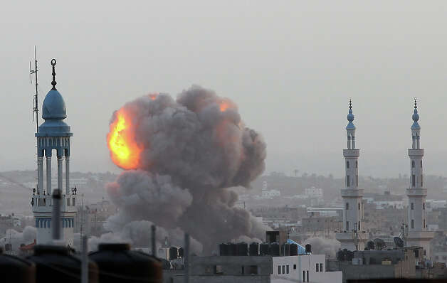 A fire ball rises as the Israeli air force carries out a raid over Gaza City on November 17, 2012, for the fourth consecutive day. Medics said 40 Gazans have been killed and more than 350 wounded since Israel launched an aerial campaign on the enclave on November 14, afternoon, with at least five militants among the 10 people killed in today's raids. Photo: AFP, AFP/Getty Images / 2012 AFP