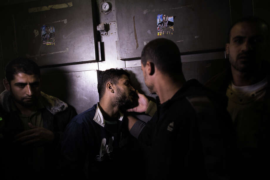 Palestinian Khaled Tafesh mourns the death of his 10-month-old daughter Hanen at a morgue in Gaza City on November 16, 2012, who was killed the day before following an Israeli air strike in the Zeitun neighborhood. Israeli warplanes carried out multiple new air strikes on the Palestinian territory, including several hits on Gaza City, the third day of an intensive campaign which the military has said is aimed at stamping out rocket fire on southern Israel Photo: MARCO LONGARI, AFP/Getty Images / 2012 AFP
