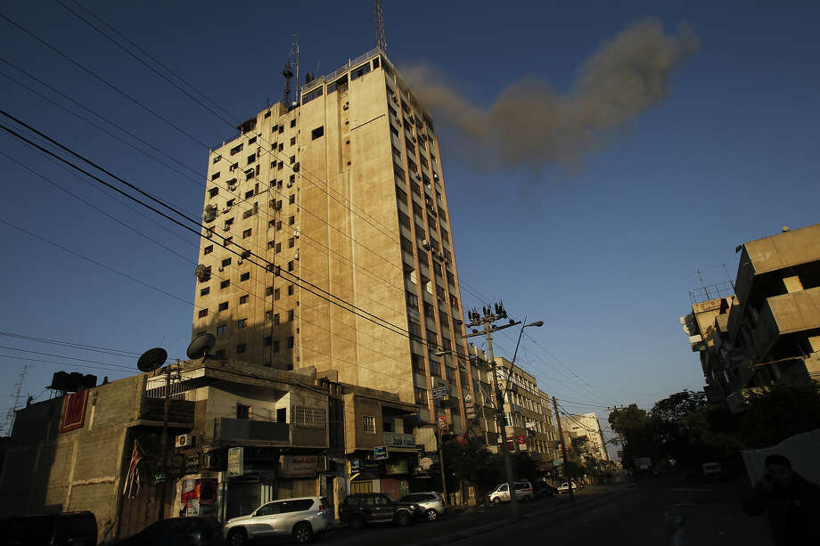 Smoke rises after an Israeli air strike on an office of Hamas television channel Al-Aqsa in Gaza City on November 18, 2012.  An Israeli air strike hit a Gaza City media building on November 18, injuring at least six journalists, as a separate raid in northern Gaza killed two people, Palestinian medical sources said. Photo: MOHAMMED ABED, AFP/Getty Images / 2012 AFP