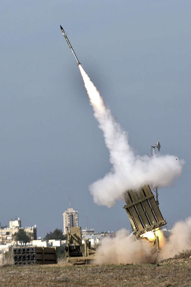 An Israeli missile is launched from the Iron Dome defense missile system, designed to intercept and destroy incoming short-range rockets and artillery shells, in the southern Israeli city of Ashdod in response to a rocket launched from the nearby Palestinian Gaza Strip on November 18, 2012. Sirens sounded across Tel Aviv for a fourth straight day, AFP correspondents said, as Israeli police confirmed two rockets had been intercepted over the city by the Iron Dome defense system. Photo: JACK GUEZ, AFP/Getty Images / 2012 AFP