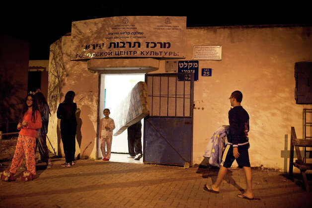 Israeli stand outside a bomb shelter on November 14, 2012 in Netivot, Israel. Israel Defense Forces launched aerial attacks on targets in Gaza that killed the top military commander of Hamas. Photo: Uriel Sinai, Getty Images / 2012 Getty Images