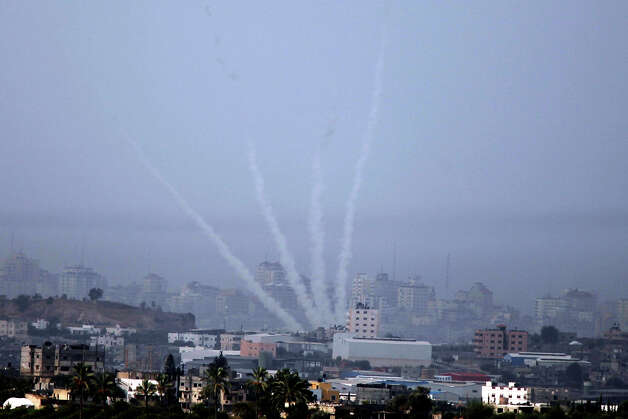 A rocket is launched from Gaza as seen from near Sderot on November 17, 2012 in  Israel. At least 39 Palestinians and three Isreali's have died since conflict began four days ago. Israeli troops have been massing on the border as some 200 targets were hit overnight in Gaza, including Hamas cabinet buildings. Photo: Lior Mizrahi, Getty Images / 2012 Getty Images