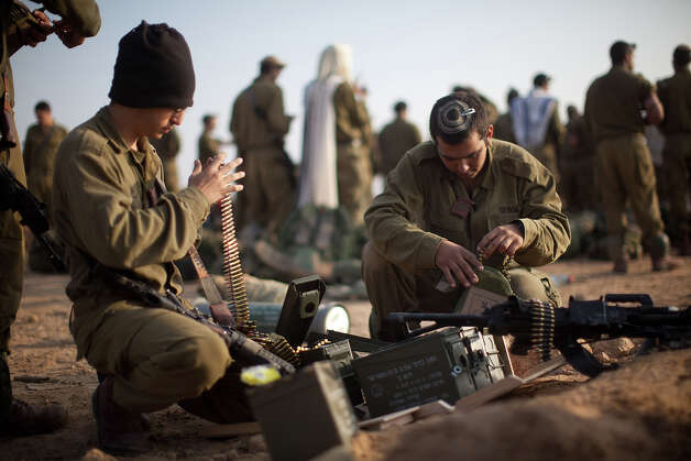 Israeli soldiers prepare weapons in a deployment area on November 19, 2012 on Israel's border with the Gaza Strip. The death toll has risen to at least 85 killed in the air strikes, according to hospital officials, on day six since the launch of operation 'Pillar of Defense.' Photo: Uriel Sinai, Getty Images / 2012 Getty Images