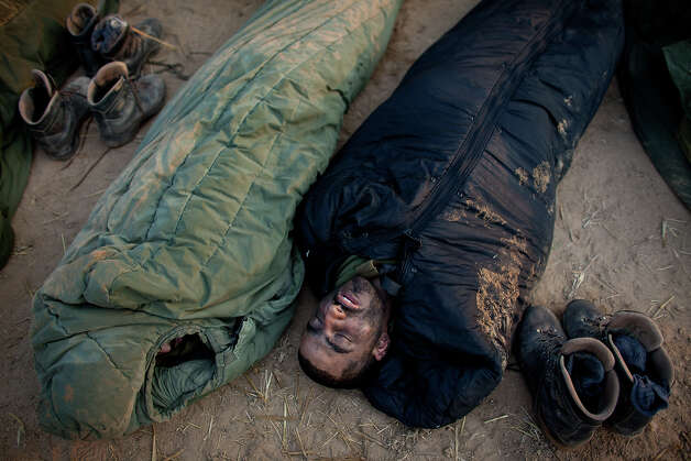 ISRAEL/GAZA BORDER, ISRAEL- NOVEMBER 19:  (ISRAEL OUT) Israeli soldiers sleep in a deployment area on November 19, 2012 on Israel's border with the Gaza Strip. The death toll has risen to at least 85 killed in the air strikes, according to hospital officials, on day six since the launch of operation 'Pillar of Defense.' Photo: Uriel Sinai, Getty Images / 2012 Getty Images