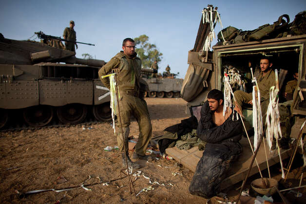 Israeli soldiers wake in a deployment area on November 19, 2012 on Israel's border with the Gaza Strip. The death toll has risen to at least 85 killed in the air strikes, according to hospital officials, on day six since the launch of operation 'Pillar of Defense.' Photo: Uriel Sinai, Getty Images / 2012 Getty Images