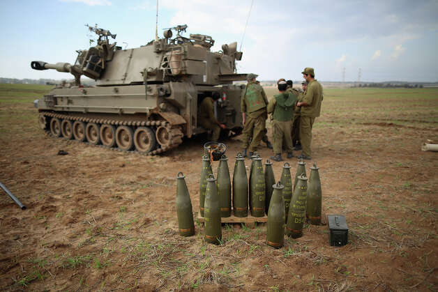 Israeli soldiers prepare an artillery emplacement overlooking Gaza on November 19, 2012 on Israel's border with the Gaza Strip. The death toll has risen to at least 85 killed in the air strikes, according to hospital officials, on day six since the launch of operation 'Pillar of Defense.' Photo: Christopher Furlong, Getty Images / 2012 Getty Images