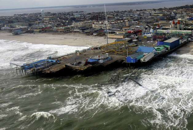 This aerial photo made during a tour of damage from Superstorm Sandy shows Casino Pier in Seaside Heights, N.J., on Sunday, Nov. 18, 2012. Vice President Joe Biden rode a separate helicopter to survey the storm damage. Photo: Rich Schultz, AP / FR27227 AP