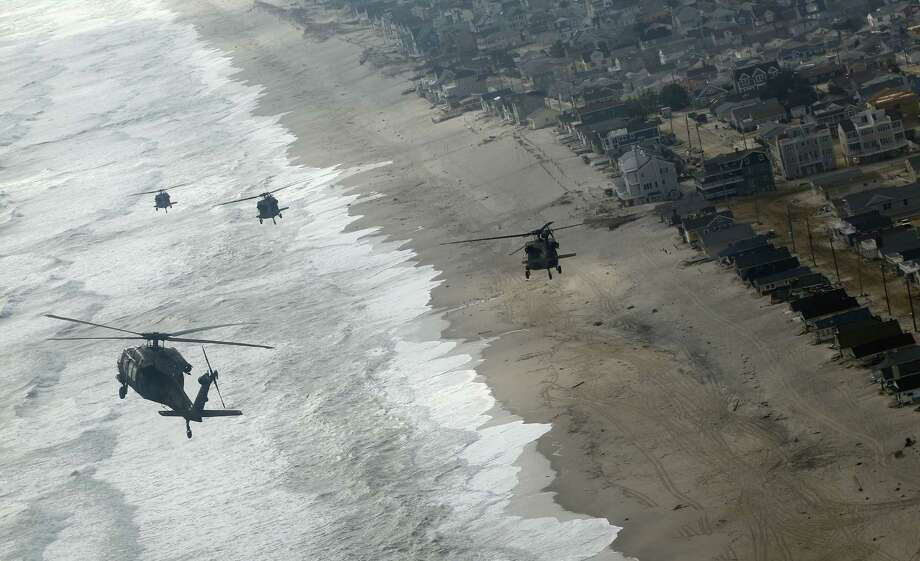 Four Air Force Black Hawk helicopters, one with Vice President Joe Biden onboard, approaches Seaside Park, N.J., Sunday, Nov. 18, 2012. The Vice President is in New Jersey to tour the damage and thank first responders from Superstorm Sandy. Photo: Rich Schultz, AP / FR27227 AP