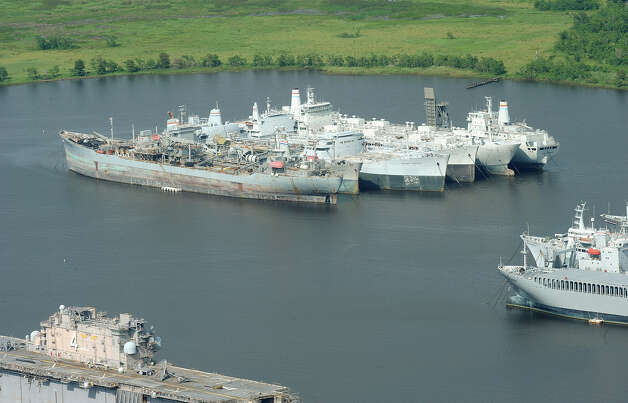 The U.S. Maritime Administration is spending at least $34 million to build eight berths for roll-on, roll-off cargo ships at the Beaumont Reserve Fleet anchorage in the Neches River. The berths are for ships like the Cape Vincent and the Cape Victory, which once were anchored at the Port of Beaumont but were later moved to the Reserve Fleet to cut costs. The ships are used for moving military cargoes around the world and the Port of Beaumont is the nation's busiest mover of military equipment. The berths will be 1,000 feet apiece and will consolidate in one place other Ready Reserve ships that are anchored in other ports. Each ship will have a crew of 10, according to the Maritime Administration. Photo taken July 7, 2012 Guiseppe Barranco/The Enterprise Photo: Guiseppe Barranco, STAFF PHOTOGRAPHER / The Beaumont Enterprise