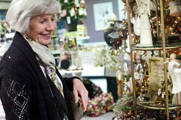 Port Arthur resident Melaine Andrews Sunday looked at Christmas decorations at the Collection in Groves. The store was participating in the Christmas Tree Trail, a festive kickoff for the holiday shopping season that encourages residents to shop locally. Photo: Sarah Moore