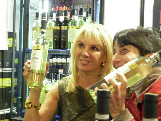 Were you seen at Ramona Singer's wine tasting? TV star Ramona Singer signs bottles of her new red and white wine at Bev Max in Stamford. 11/15/2012 Photo: Todd Tracy