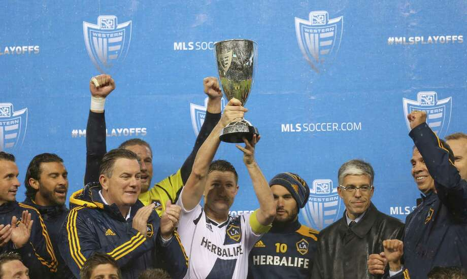 SEATTLE, WA - NOVEMBER 18:  Robbie Keane #7 of the Los Angeles Galaxy hoists the Western Conference Championship trophy after defeating the Seattle Sounders FC 2-1, winning the aggregate playoff 4-2 during Leg 2 of the Western Conference Championship at CenturyLink Field on November 18, 2012 in Seattle, Washington. Photo: Otto Greule Jr, Getty Images / 2012 Getty Images