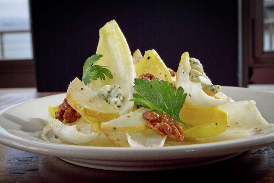 """""""One of the best salads combines frisee and Belgian endive ($9), tossed with slices of Asian pear, candied walnuts and blue cheese that balances the sweetness of the other ingredients."""" Photo: John Storey, Special To The Chronicle / John Storey"""