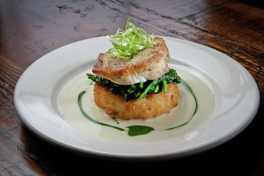 """...That's not the case with the line-caught dorado ($23), perched on a crisp risotto cake with sauteed spinach and a lemon caper butter sauce; it does the kitchen proud."" Photo: John Storey, Special To The Chronicle / John Storey"