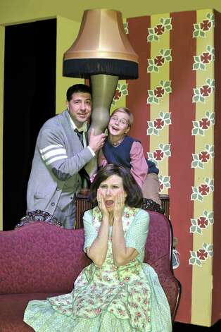 "Theresa Bishop (clockwise from front), Bob Galindo and Cutter Grant play a family in the Woodlawn Theatre's staging of ""A Christmas Story."" Courtesy Sandra Trevino Photo: Courtesy Sandra Trevino"