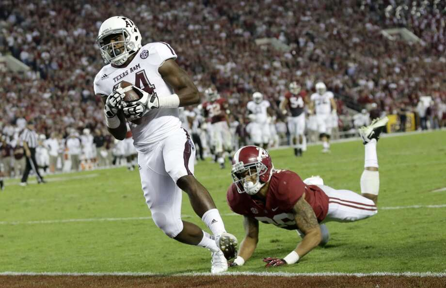 Texas A&M wide receiver Malcome Kennedy (84) catches the game winning touchdown as Alabama defensive back Dee Milliner (28) defends during the second half of an NCAA college football game at Bryant-Denny Stadium in Tuscaloosa, Ala., Saturday, Nov. 10, 2012. (AP Photo/Dave Martin) (Associated Press)