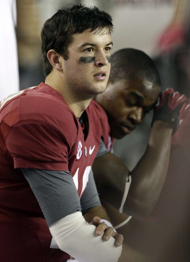 Alabama quarterback AJ McCarron (10) watches from the sidelines during the second half of an NCAA college football game against Texas A&M at Bryant-Denny Stadium in Tuscaloosa, Ala., Saturday, Nov. 10, 2012. Texas A&M won 29-24. (AP Photo/Dave Martin) (Associated Press)