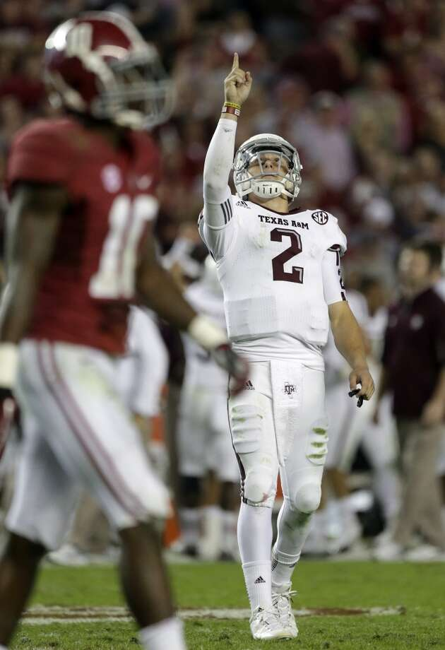 Texas A&M quarterback Johnny Manziel (2) reacts during the second half of an NCAA college football game against Alabama at Bryant-Denny Stadium in Tuscaloosa, Ala., Saturday, Nov. 10, 2012. Texas A&M won 29-24. At left is Alabama defensive back John Fulton (10) .  (AP Photo/Dave Martin) (Associated Press)
