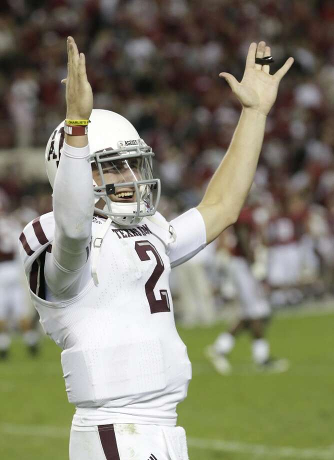 Texas A&M quarterback Johnny Manziel (2) reacts during the second half of an NCAA college football game against Alabama at Bryant-Denny Stadium in Tuscaloosa, Ala., Saturday, Nov. 10, 2012. Texas A&M won 29-24. (AP Photo/Dave Martin) (Associated Press)