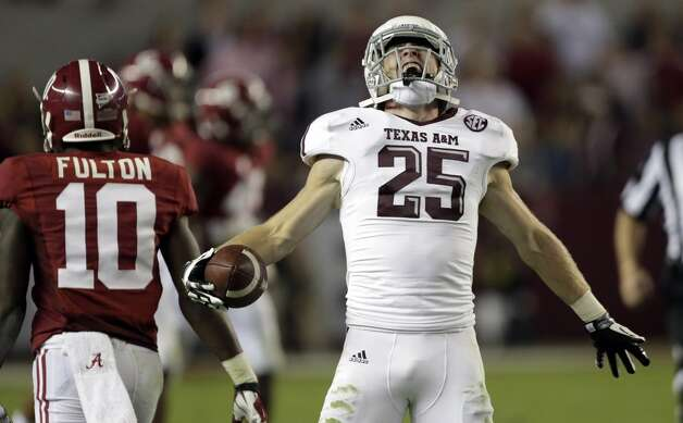 Texas A&M wide receiver Ryan Swope (25) reacts after making a critical first down catch in the fourth quarter of a 29-24 win over top ranked Alabama during an NCAA college football game at Bryant-Denny Stadium in Tuscaloosa, Ala., Saturday, Nov. 10, 2012.  (AP Photo/Dave Martin) (Associated Press)