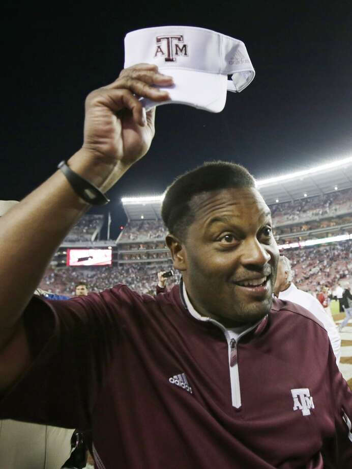 Texas A&M coach Kevin Sumlin tips his cap following a 29-24 win over top ranked Alabama during an NCAA college football game at Bryant-Denny Stadium in Tuscaloosa, Ala., Saturday, Nov. 10, 2012.  (AP Photo/Dave Martin) (Associated Press)