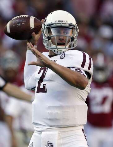 Texas A&M quarterback Johnny Manziel (2) looks for a receiver during the first half of an NCAA college football game against Alabama at Bryant-Denny Stadium in Tuscaloosa, Ala., Saturday, Nov. 10, 2012. (AP Photo/Dave Martin) (Associated Press)