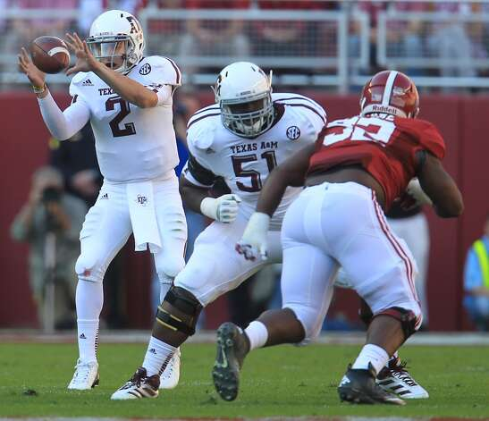 Texas A&M quarterback Johnny Manziel (2) takes a snap during the first quarter of a college football game at Bryant-Denny Stadium, Saturday, Nov. 10, 2012, in Tuscaloosa.  ( Karen Warren / Houston Chronicle ) (Houston Chronicle)