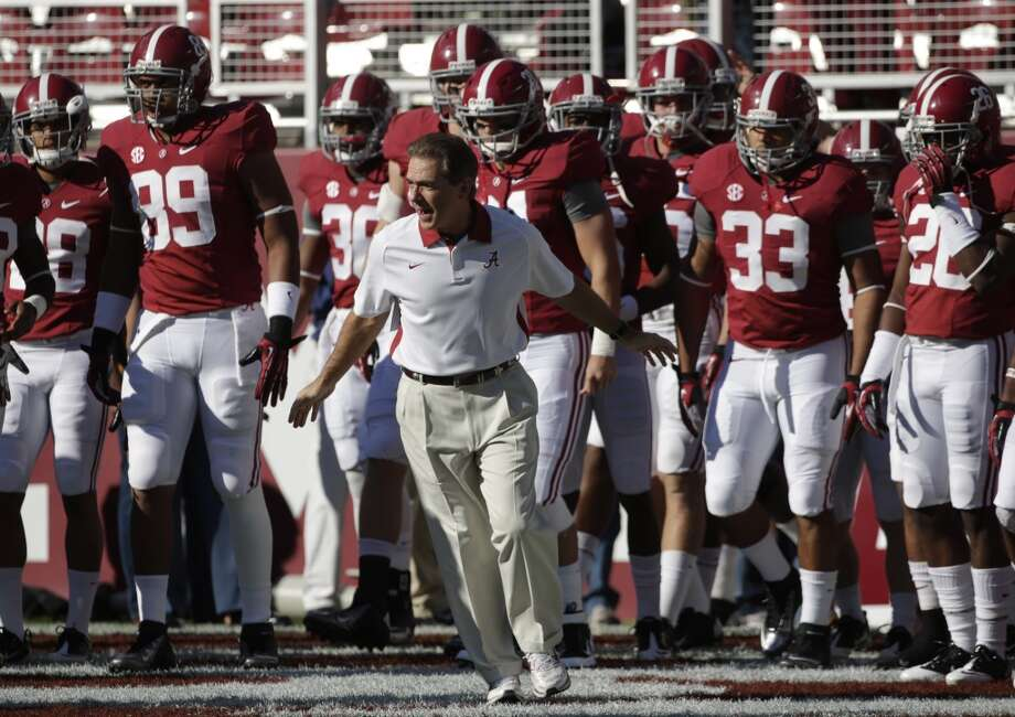 Alabama coach Nick Saban runs on to the field with his team prior to the start of an NCAA college football game against Texas A&M at Bryant-Denny Stadium in Tuscaloosa, Ala., Saturday, Nov. 10, 2012. (AP Photo/Dave Martin) (Associated Press)