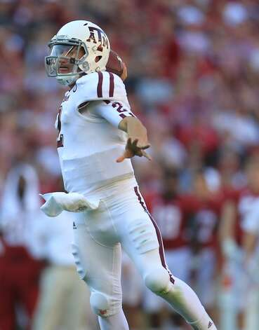 Texas A&M quarterback Johnny Manziel (2) throws a touchdown pass to Texas A&M wide receiver Ryan Swope (25) during the first quarter of a college football game at Bryant-Denny Stadium, Saturday, Nov. 10, 2012, in Tuscaloosa.  ( Karen Warren / Houston Chronicle ) (Houston Chronicle)