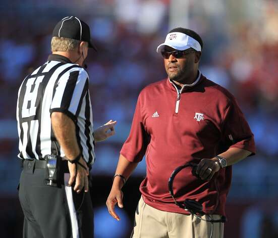 Texas A&M head coach Kevin Sumlin talks to a referee during the first quarter of a college football game at Bryant-Denny Stadium, Saturday, Nov. 10, 2012, in Tuscaloosa.  ( Karen Warren / Houston Chronicle ) (Houston Chronicle)
