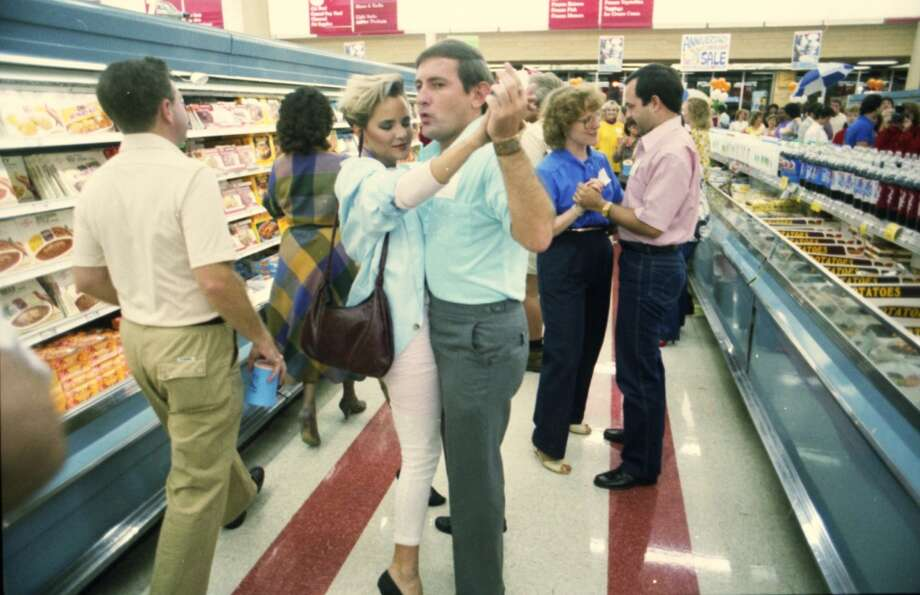 Dancing in the aisle at Rice Food Market singles event, 1986.