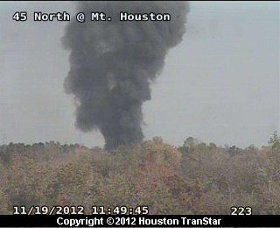 Smoke can be seen from a fire at a vehicle salvage yard on Airline near the North Freeway in north Harris County late Monday morning. Photo: Houston Transtar