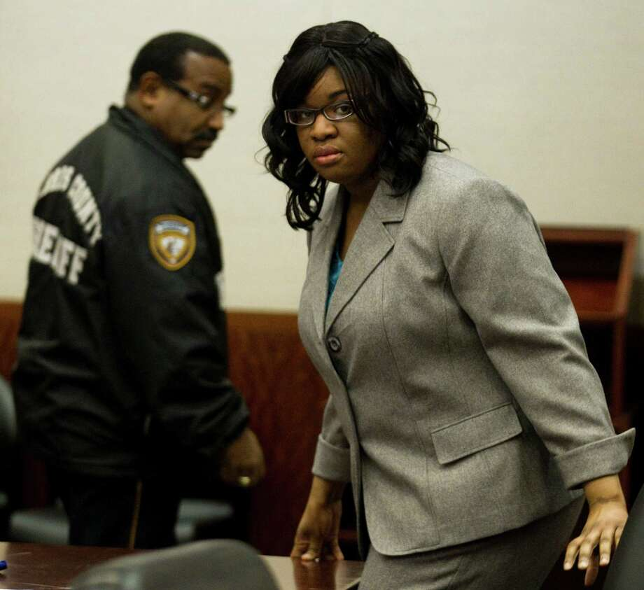 Jessica Tata takes a seat in the courtroom during the closing arguments of the punishment phase of her trial Monday, Nov. 19, 2012, in Houston. Tata was convicted of felony murder in the deaths of four toddlers during a fire at her day care in 2011. Photo: Brett Coomer, Houston Chronicle / © 2012 Houston Chronicle