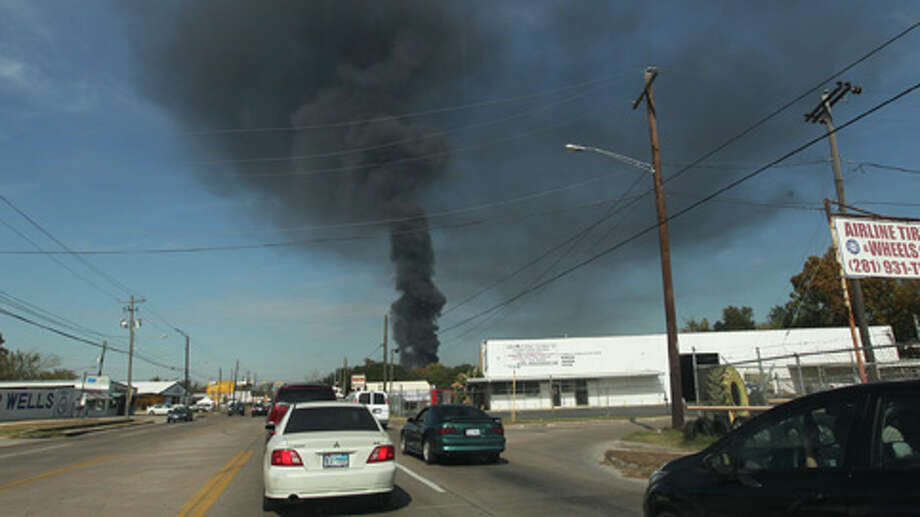 Smoke was seen for miles after a large fire broke out at an automobile salvage yard in north Harris County. Photo: .
