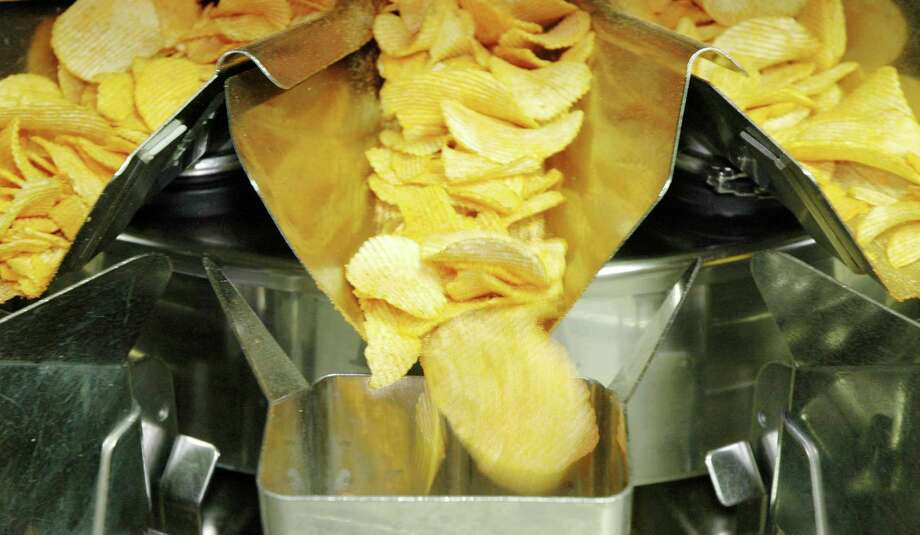 Caffeine-coated ``energy chips'' called NRG Phoenix Fury Potato Chips, were introduced by Golden Flake Snack Foods in 2007. You can order them online at www.nrgsnax.com. Photo: Jay Reeves, AP / AP