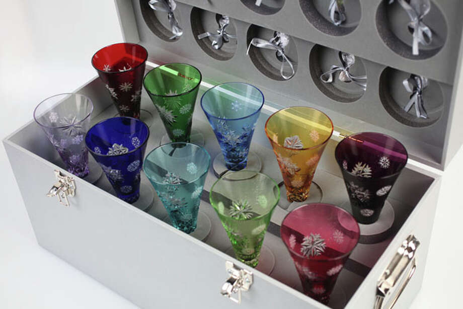 Luxury Gifts - This Waterford Crystal Snowflake Wishes Collection includes 10 champagne flutes (one for each year from 2011 to 2020). Each flute is decorated in a fanciful snowflake and the colors include ruby, emerald, light blue, amber, amethyst, lavender, cobalt blue, aqua, chartreuse and cranberry. The set is priced at $3,000, at Dillard's North Star Mall. Photo: Juanito M Garza, Express-News / San Antonio Express-News