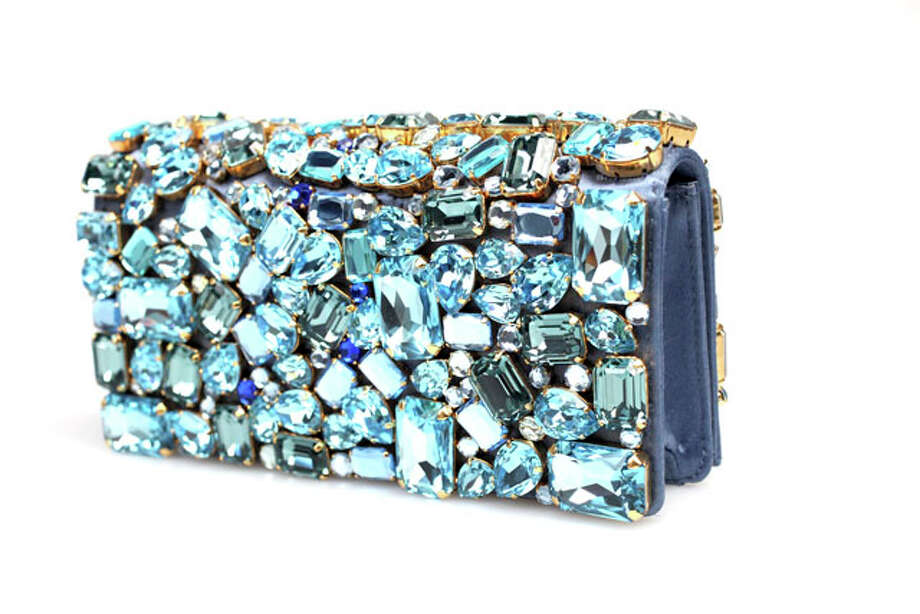 Luxury Gifts - Prada blue stone-embellished clutch, $2,100, Saks Fifth Avenue at North Star Mall. Photo: Juanito M Garza, Express-News / San Antonio Express-News