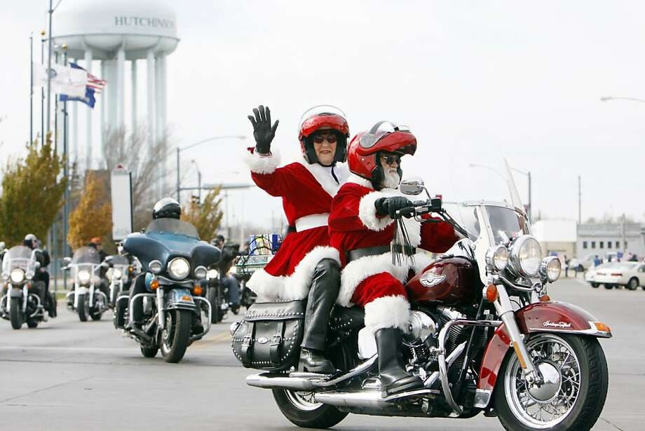 North Pole's Angels:Forget the sleigh and eight little reindeer, these days Santa and Mrs. Claus ride Harleys. The jolly old elf was revving up for Christmas with a Toy Run in Hutchinson, Kan. Photo: Lindsey Bauman, Associated Press