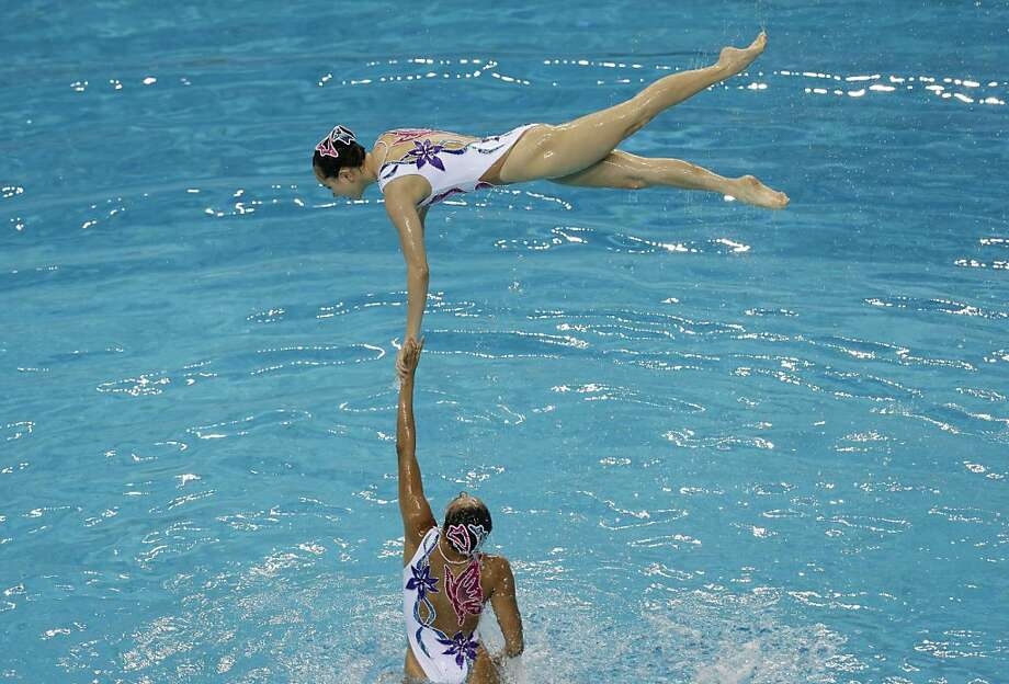 Grand hand stand:With feats of strength and balance like this, it's no wonder China won the team gold medal in free synchronized swimming at the Asian Swimming Championships in Dubai. Photo: Hassan Ammar, Associated Press