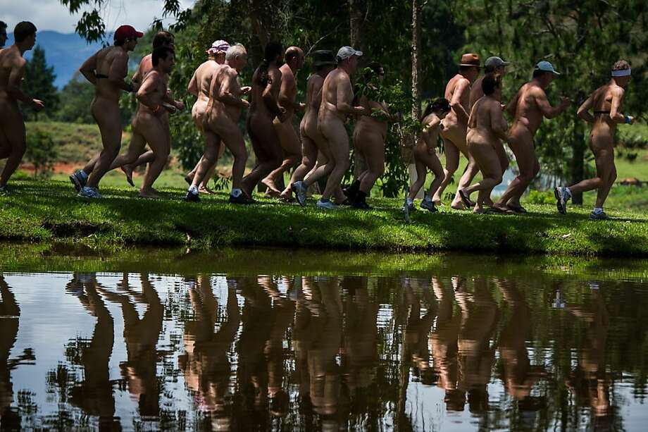 Naturists run the 3 km Marathon during the first Brazilian Naturist Olympics in Guaratingueta, about 200 km east of Sao Paulo, Brazil on Novemeber 18, 2012. For 3 days, around 60 members of the Brazilian Federation of Naturism have competed in 30 disciplines. Photo: Yasuyoshi Chiba, AFP/Getty Images