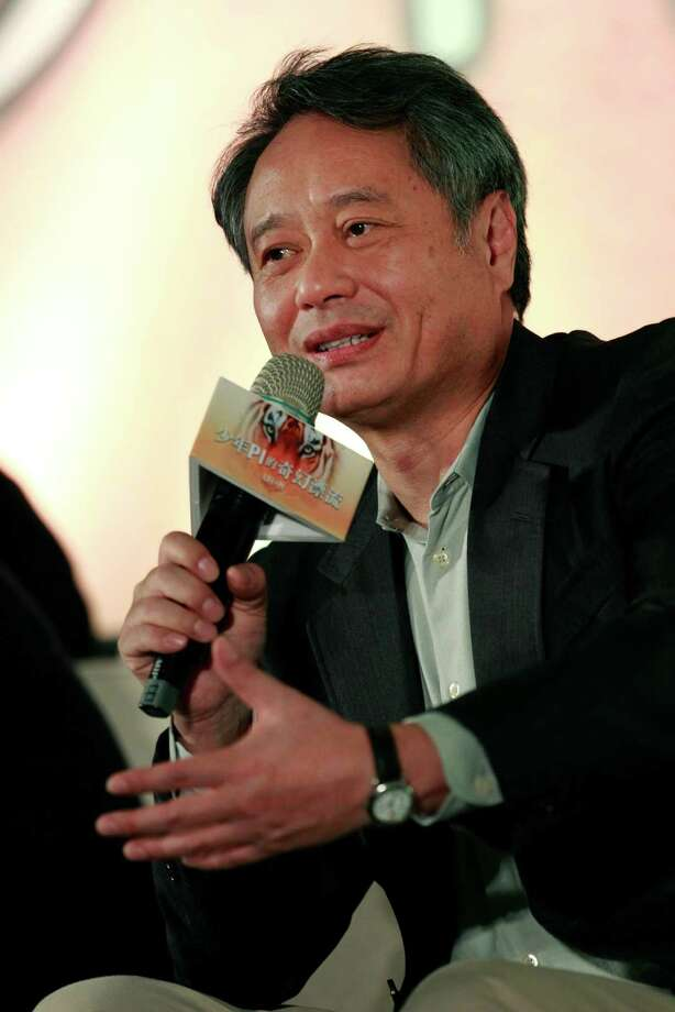 "Taiwanese director Ang Lee answers questions during a press conference announcing their new film ""Life of Pi,"" in Taipei, Taiwan, Wednesday, Nov. 7, 2012. ""Life of Pi"" is an upcoming 3D adventure film based on the 2001 novel of the same name by Yann Martel, staring Suraj Sharma and directed by Lee. (AP Photo/Wally Santana) Photo: Wally Santana, Associated Press / AP"