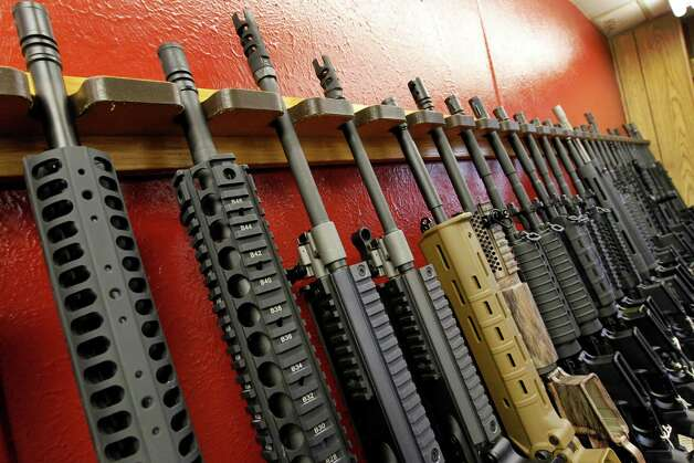 A row of different AR-15 style rifles are displayed for sale at the Firing-Line indoor range and gun shop, Thursday, July 26, 2012 in Aurora, Colo.  (AP Photo/Alex Brandon) Photo: Alex Brandon, STF / AP