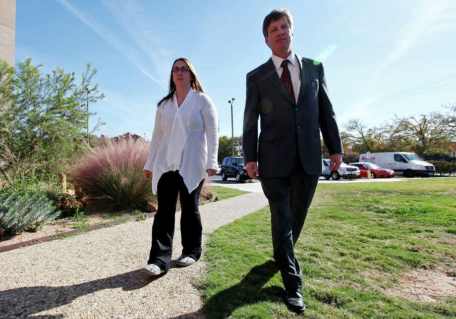 Attorney Kevin Glasheen (right) walks Heather Sanchez to a press conference at the Midland County Courthouse Monday Nov. 19, 2012, in Midland, Tx. Glasheen and Bob Pottroff (not pictured) are representing U.S. Army Sgt. Richard Sanchez and his wife Heather, who were riding on a parade float, Thursday Nov. 15, 2012  carrying veterans injured in combat and their spouses to a banquet in their honor, that was struck by a Union Pacific train. Four men died in the crash, including one from the San Antonio area. Richard Sanchez is one of three people that remains hospitalized after the crash. Photo: Edward A. Ornelas, San Antonio Express-News / © 2012 San Antonio Express-News