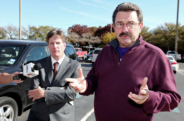 Attorneys Kevin Glasheen (left) and Bob Pottroff answer questions after a press conference at the Midland County Courthouse Monday Nov. 19, 2012, in Midland, Tx. Glasheen and Pottroff are representing U.S. Army Sgt. Richard Sanchez and his wife Heather, who were riding on a parade float, Thursday Nov. 15, 2012  carrying veterans injured in combat and their spouses to a banquet in their honor, that was struck by a Union Pacific train. Four men died in the crash, including one from the San Antonio area. Richard Sanchez is one of three people that remains hospitalized after the crash. Photo: Edward A. Ornelas, San Antonio Express-News / © 2012 San Antonio Express-News