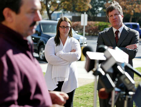 Heather Sanchez, whose husband, Sgt. Richard Sanchez, was injured in the train wreck, and attorney Kevin Glasheen (right) listen as lawyer Bob Pottroff answers questions during a news conference in Midland. Photo: Edward A. Ornelas, San Antonio Express-News / © 2012 San Antonio Express-News