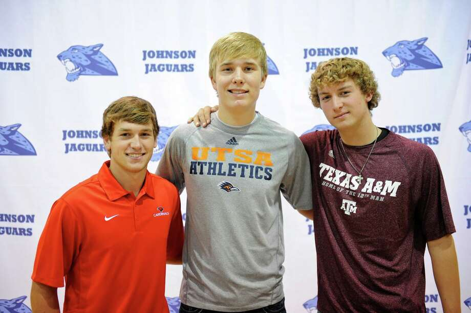 Johnson High School athletes (from left) Mark Whitehead, Luke Wilshire and Jake Goodman signed letters of intent last week to continue their sports careers in college. Photo: John Albright / For North Centra / John Albright / www.johnalbrightphoto.com
