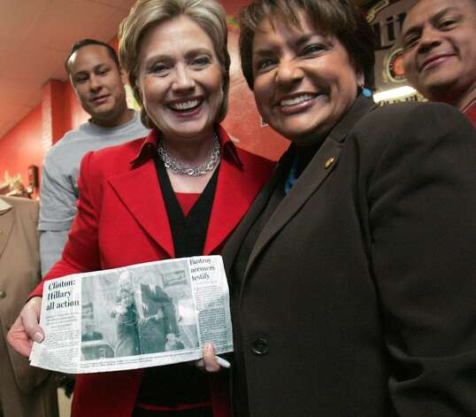 Democratic presidential hopeful Sen. Hillary Clinton holds a photograph of her husband former President Bill Clinton embracing Dallas City Council member Pauline Medrano (right) that was made during a campaign rally stop in Dallas, Texas, last week on Tuesday, March 4, 2008. Photo: JIM MAHONEY, MCT / Dallas Morning News
