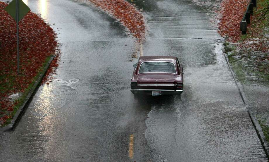 Cars drive along a flooded section of Lake Washington Boulevard East during a significant rainfall on Monday, November 19, 2012. Photo: JOSHUA TRUJILLO / SEATTLEPI.COM